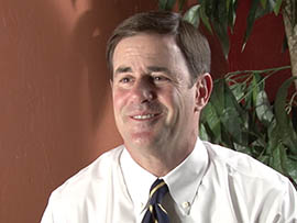 Republican Doug Ducey says he agrees with Gov. Jan Brewer's decision to appeal a court ruling saying the state must make a first payment of $317 million to reimburse schools for  shorting base funding since 2010 in violation of a voter-approved law.