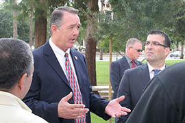 U.S. Rep. Trent Franks talks with Arizonans who are members of a Middle Eastern group called the Yazidis. Franks and members of the group held a news conference Thursday to say the Obama administration isn't doing enough to protect Yazidis and other non-Muslim groups from the Islamic State group.