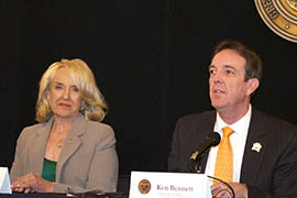 Gov. Jan Brewer watches as Secretary of State Ken Bennett explains the official canvass of general election results.