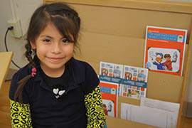 Ashley Vaca, a first-grader at Dunbar Elementary School, said because of the Experience Corps program she now loves to read especially, about Clifford the Big Red Dog.