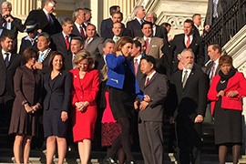 Martha McSally, in blue, joined incoming members of Congress for the freshman class photo, even though she still faces a recount of her slim lead over Rep. Ron Barber, D-Tucson. Arizona Rep.-elect Ruben Gallego, far left in second row, was also on hand for the photo.
