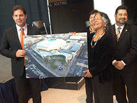 Diane Enos, president of the Salt River Pima-Maricopa Indian Community, and Phoenix Suns President Jason Rowley display an artist's rendering of signage that will adorn Talking Stick Resort Arena in downtown Phoenix.