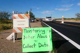 Some residents of the southern Arizona community of Arivaca are counting how many cars pass through a Border Patrol checkpoint and taking down other information to support their case that the checkpoint should close. They contend the checkpoint militarizes the area and costs them time.
