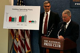 Stephen Brobeck, right, of the Consumer Federation of America and Mike Schenck of the Credit Union National Association deliver the 2014 outlook for holiday spending, which is expected to be slightly higher than last year.