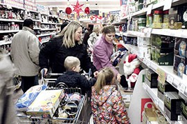 Overall holiday spending is expected to be up from last year's levels, but only because of higher-income Americans. Most people said they expect to spend the same or less as last year.