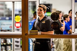 An employee at a Best Buy checks the door before the Black Friday shopping rush in this file photo from a previous Thanksgiving.