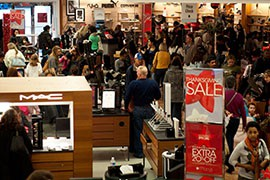 Macy's, shown here on a previous Black Friday, is one of the stores that will open to holiday shoppers on the evening of Thanksgiving Day.