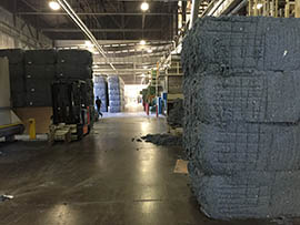 Bales of material made from recycled blue jeans at Bonded Logic in Chandler.