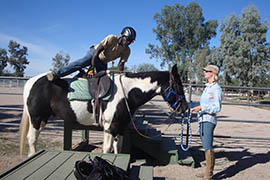 Joseph Bailey Jr., a Navy veteran, mounts Fiesta as part of his therapy through the Heroes on Horses program in Tucson.