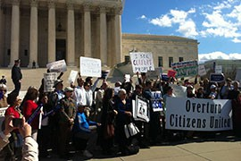 Protesters outside the Supreme Court in 2012 rally against the court's decision in Citizens United, one of two rulings that has helped boost the influence of so-called