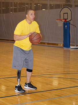 David Banks said he founded a stand-up basketball league for amputees because wheelchair leagues were the only outlet available to him.