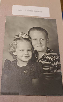 A scrapbook photo shows Danielle Stephens and her brother Dan Bishop, who grew up on a ranch outside of Kingman.