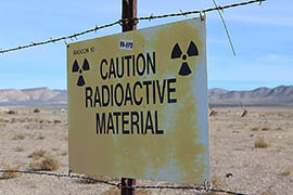A sign cautions employees of the potential radiation risks at the Nevada National Security Site, previously called the Nevada Test Site. The area is now maintained by the U.S. Department of Energy.