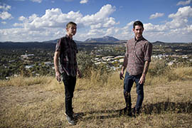 Zander Tatum, left, and Drew Dailey talk atop a hill overlooking Prescott. Both men came to Prescott to overcome their heroin addictions.