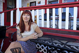 Anna Weiler sits in front of Cuppers Coffeehouse in Prescott. Weiler has been sober for five years and continues to work and participate in the recovery community in the city.