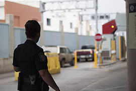 Marcia Armendariz, a supervisor in the Public Affairs Office of Customs and Border Protection, watches as cars pass through the Nogales port of entry.