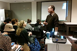 Gregory Sale, an associate professor of intermedia and public practice, speaks at a screening of