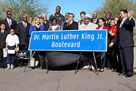 Community leaders and elected officials unveil a sign Thursday that will add the ceremonial name Dr. Martin Luther King Jr. Boulevard to Broadway Road in Phoenix.