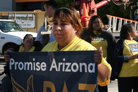 Maria Olague, who is on the waiting list for a federal deferred action program allowing immigrant parents to remain in the U.S. legally, demonstrates Friday outside the Phoenix office of Sen. John McCain with members of Promise Arizona.