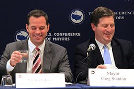 White House official Michael Boots, right, and Phoenix Mayor Greg Stanton discuss climate change at the U.S. Conference of Mayors winter meeting, where Stanton chaired a meeting on the issue.