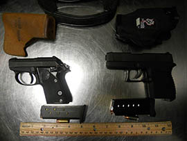 At a March 2014 news conference warning travelers against bringing guns through checkpoints, the Transportation Safety Administration displayed these examples of guns confiscated at Phoenix Sky Harbor International Airport.