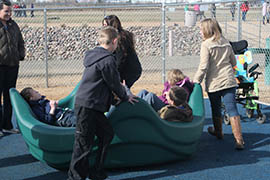 A bowl-shaped merry-go-round allows students to ride without holding on at a new inclusive playground at Mountain View Elementary School in Prescott Valley.