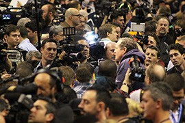 In a sea of reporters, New England Patriots Coach Bill Belichick responds to questions during Super Bowl Media Day.