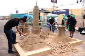 An area of Super Bowl Central promoting tourism to Mexico features a sand exhibit of that country's landmarks.