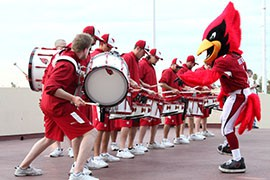 Marching band and Cardinals mascot energize the crowd.