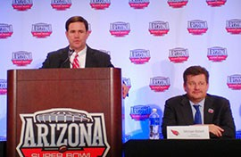 Gov. Doug Ducey, left, and Cardinals President Michael Bidwill are using the Super Bowl to attract new businesses to Phoenix.