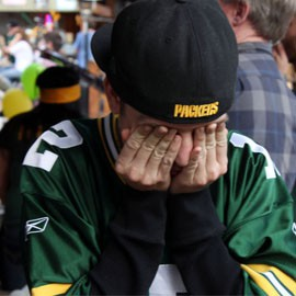 Local Green Bay Packers fans at the Buffalo Chip Saloon experience the ecstasy and then the agony of their team's stunning defeat to the Seattle Seahawks.