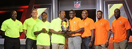 Captains Cris Carter, left, and Michael Irvin, right, pose with the coveted Pro Bowl MVP trophy surrounded by their first selections.