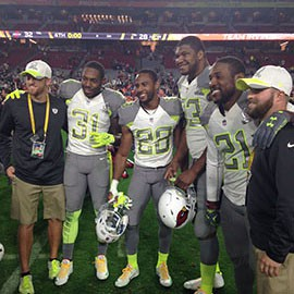 Arizona Cardinals (from left) Antonio Cromartie, Justin Bethel, Calais Campbell and Patrick Peterson pose on the field with equipment staff after the 2015 Pro Bowl at University of Phoenix Stadium in Glendale, Ariz.