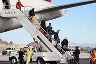 The Seahawks disembark the plane as they enter the Valley