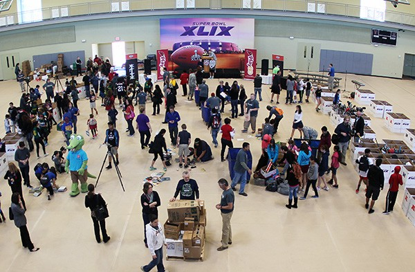 Hundreds of students and adult coordinators in the greater Phoenix area swarmed the Salvation Army South Mountain Kroc Community Center to donate more than 33,000 items to children in need. Photo by Miranda Perez