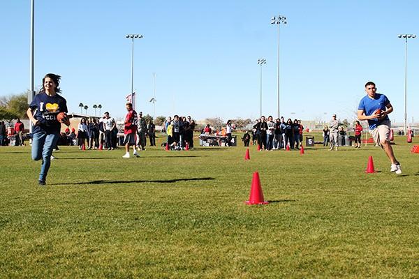 Camp participants run drills around cones as Cardinals safety Tyrann Mathieu looks on. Photo by Miranda Perez