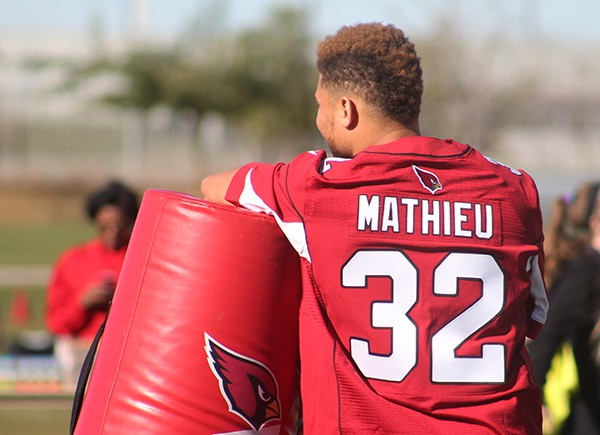 Cardinals safety Tyrann Mathieu stands by and watches intently as students participate in a variety of drills. Photo by Miranda Perez