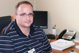 Calvary Outpatient Director of Recovery Seth Jenkins sits at his desk.