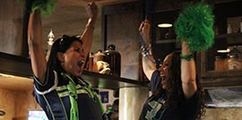 Kinzie Kimbell, left, and Jenna Mohrwels celebrate during the Seahawks' fourth-quarter comeback against the Packers.