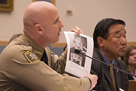 Pinal County Sheriff Paul Babeu with a photo of Grant Ronnebeck, 21, a Mesa store clerk who Babeu said was killed by an undocumented immigrant with a criminal record. Babeu was testifying to a House panel on immigration enforcement.