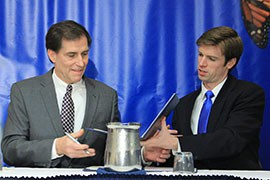 U.S. Fish and Wildlife Service Director Dan Ashe, left, and National Wildlife Federation President Collin O'Mara sign an agreement to collaborate on monarch butterfly conservation.