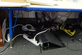 Electrical cords under a desk in an unlocked office at one of the commercial Arizona child-care centers that federal inspectors audited in 2013.