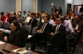 The State Board of Education meeting room fills up as board members arrive.