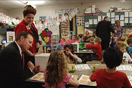 State Sen. Jeff Dial, R-Chandler, and Rep. Brenda Barton, R-Payson, visit a kindergarten class at Horseshoe Trails Elementary School in north Phoenix on Friday, Feb. 13. They have introduced bills that would require public and charter schools to add all-day kindergarten.