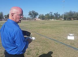 Tucson real-estate agent Doug Trudeau flies his DJI Phantom 2 drone at a park.