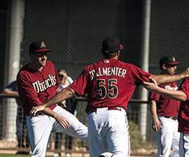 D-Backs pitchers Josh Collmenter and Daniel Hudson warm up for Spring Training practice.