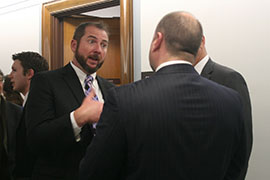 John Dodson, facing camera, speaks with Pete Forcelli, two whistleblowers who exposed a flawed gun-running operation. Both said they faced retaliation after coming forward.