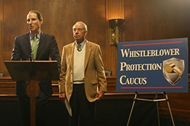 Sens. Ron Wyden, D-Ore., left, and Charles Grassley, R-Iowa, are two of 10 bipartisan members of the new caucus that aims to protect and encourage federal whistleblowers.