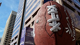 The football statue is one of the last pieces to be taken down from Super Bowl Central.