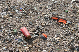 Spent shotgun shells, shattered clay targets and more litter a section of Table Mesa Recreation Area that's popular with target shooters.